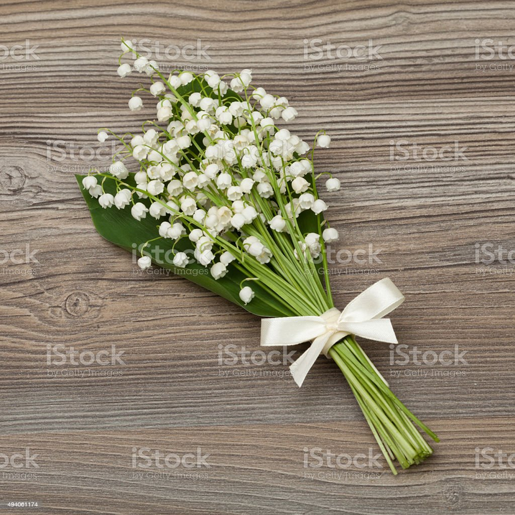 Bouquet of lily of the valley. Bouquet tied with silk ribbon. There...