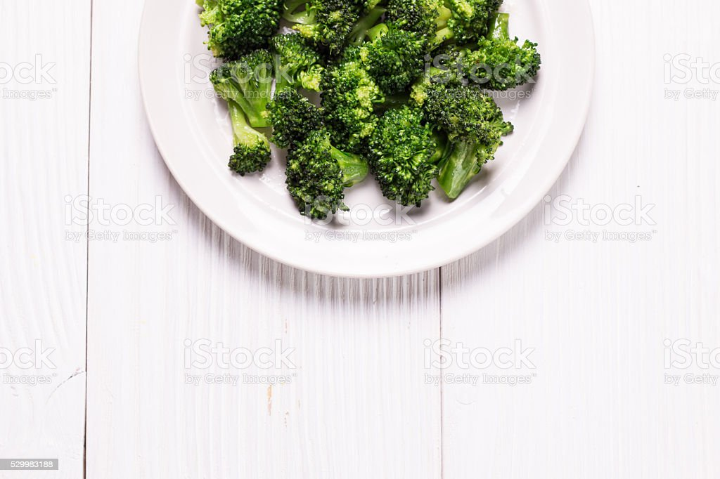 Bunch of fresh green broccoli on  wooden background stock photo