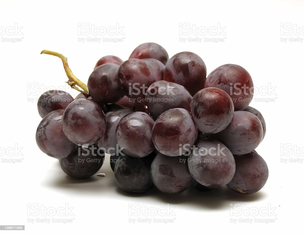 Bunch of fresh red grapes on a white surface royalty-free stock photo