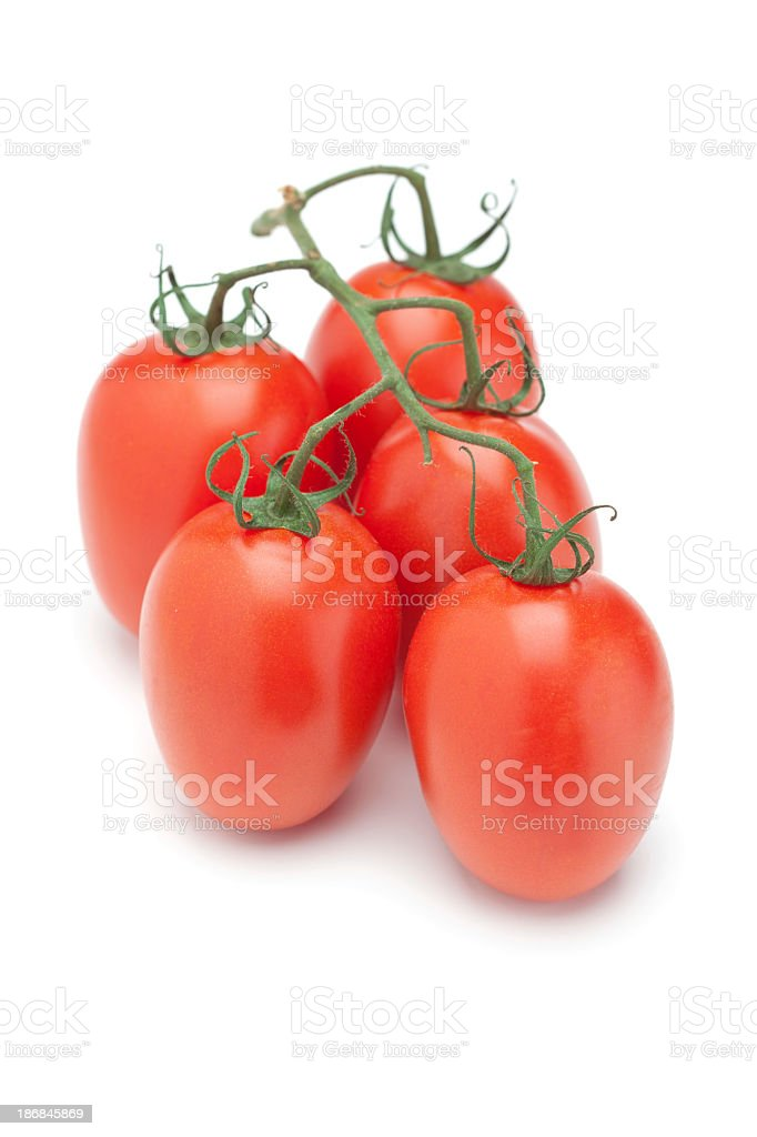 Bunch of fresh Roma Tomatoes on a white background stock photo
