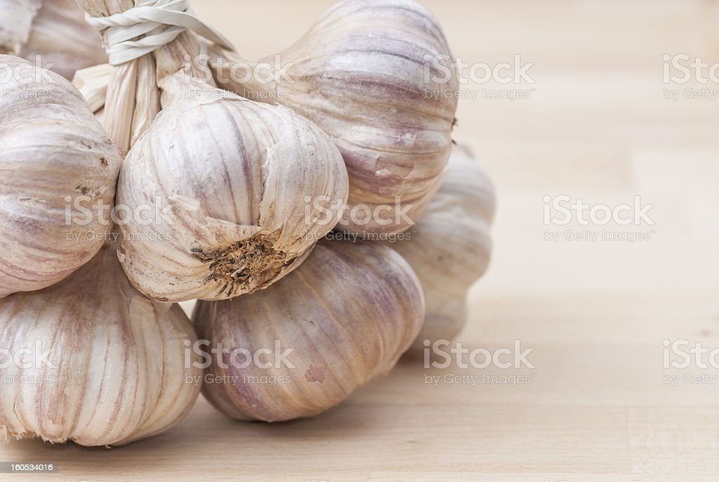 Bunch of Garlic on Wooden Surface. royalty-free stock photo
