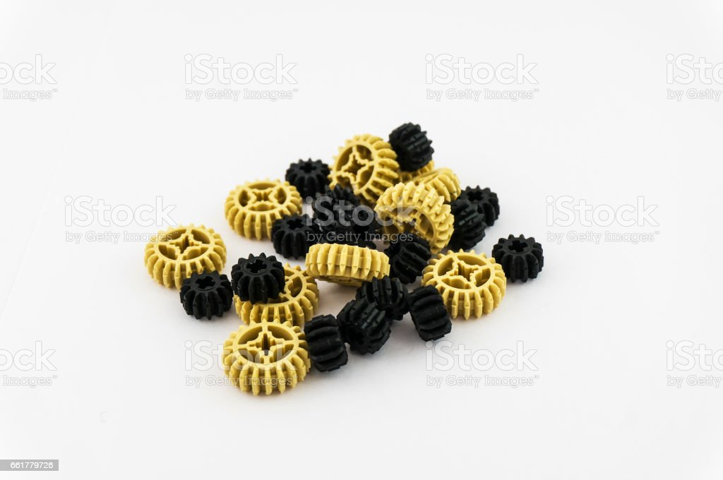 A bunch of gears made of plastic stock photo