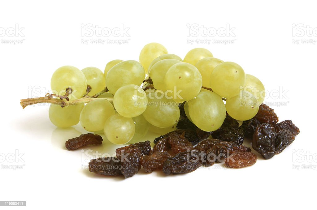 Bunch of grapes and raisins stock photo
