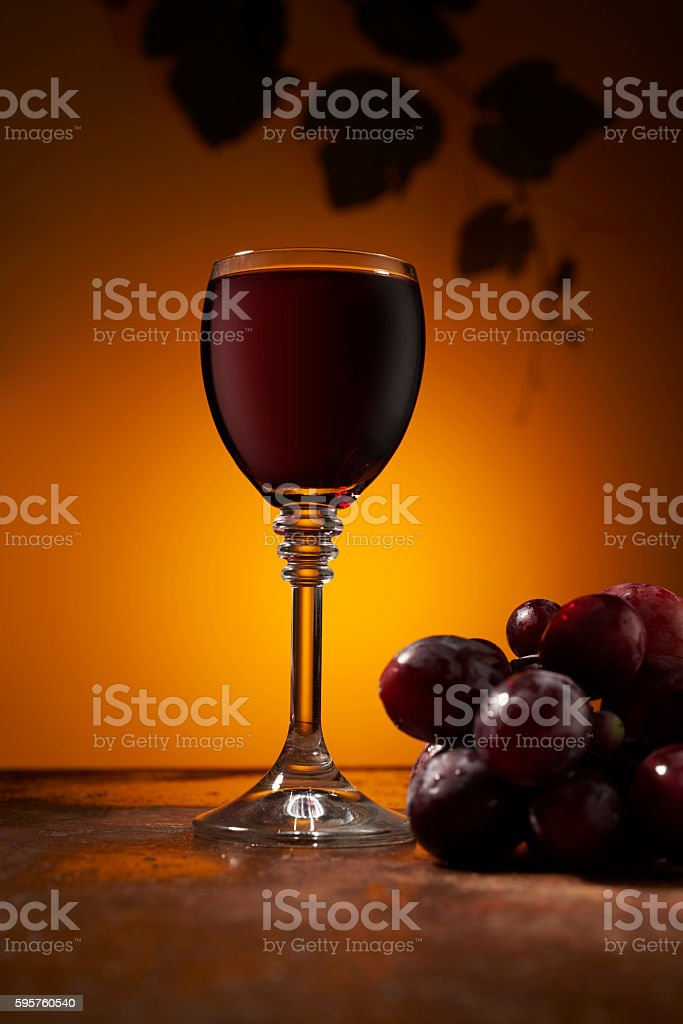 bunch of grapes and wine on the table stock photo