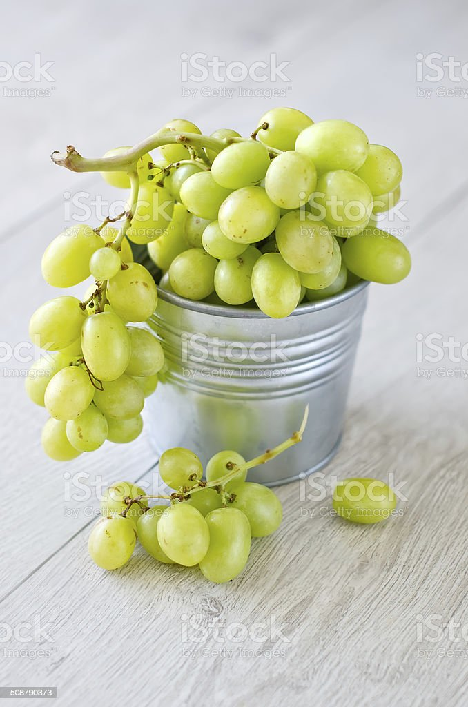 Bunch of grapes in a bucket stock photo