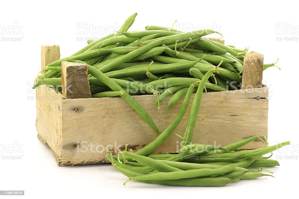 bunch of green beans in a wooden box royalty-free stock photo