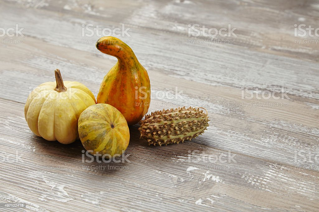 Bunch of groceries: two pumpkins, squash  on grunge wooden table stock photo