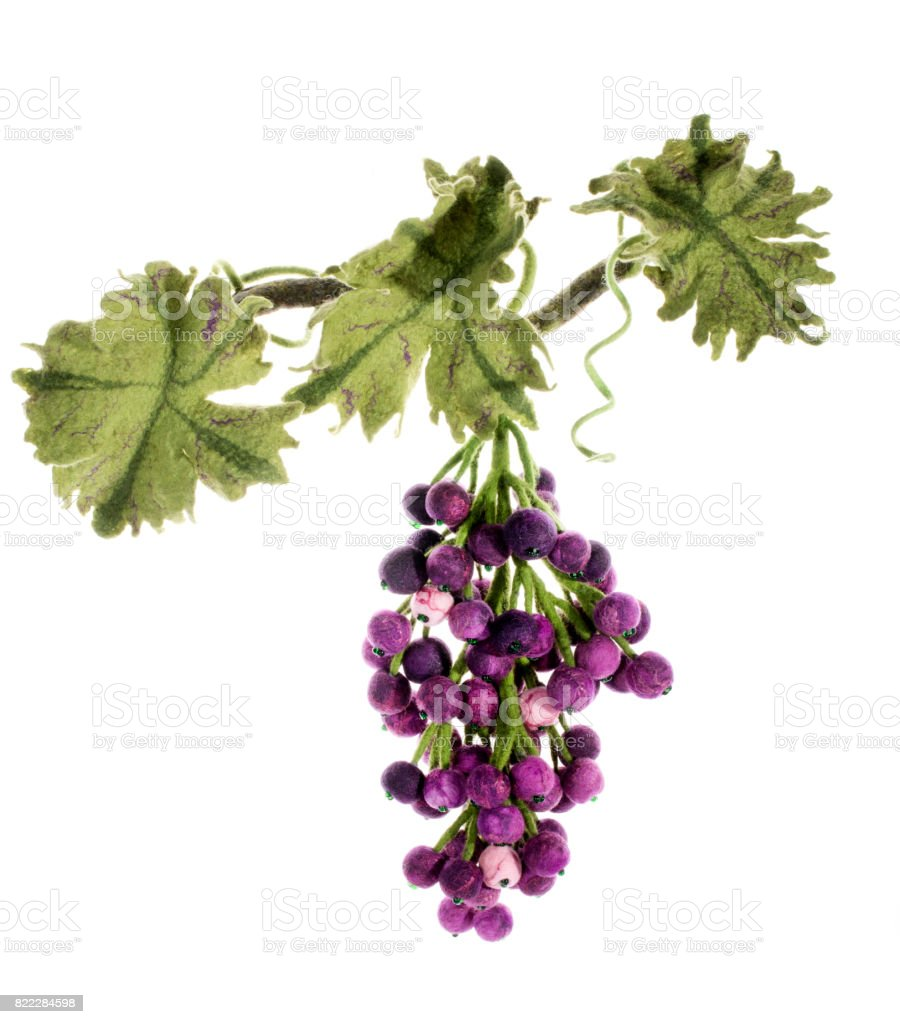 Bunch of handmade grapes from felted wool on white background stock photo