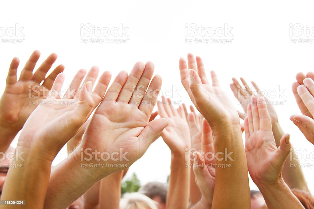 A bunch of hands in the air because they just don't care  stock photo