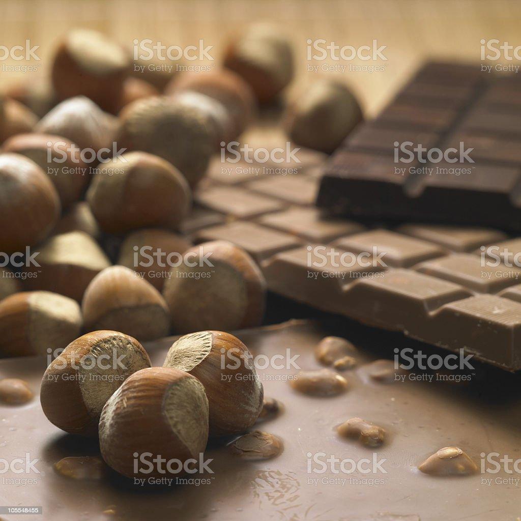 Bunch of hazelnuts and chocolate bars stock photo