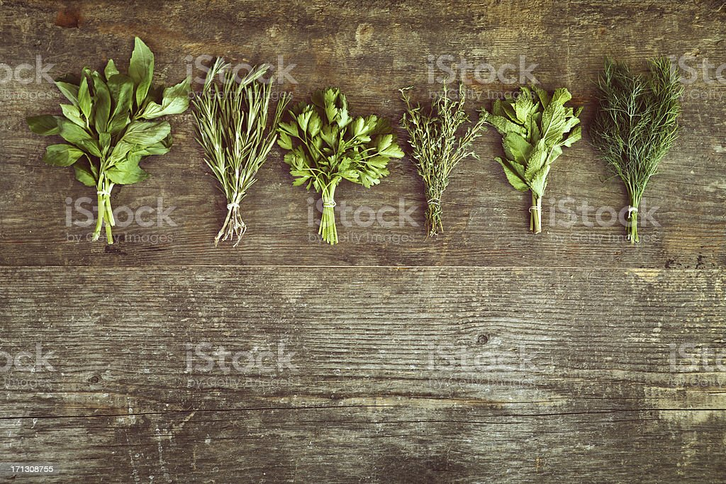 Bunch of herbs on wooden table stock photo