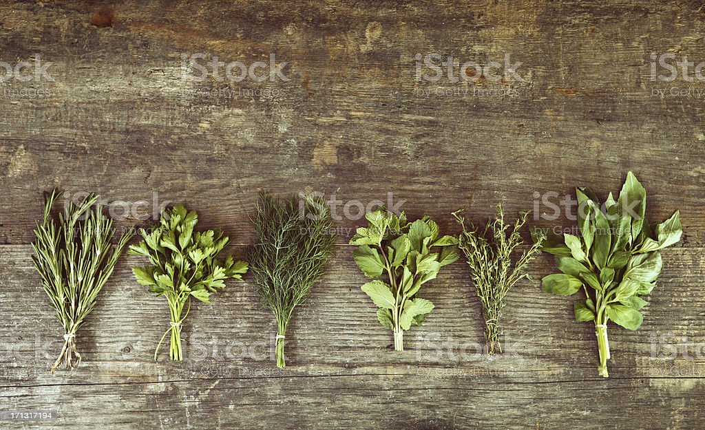 Bunch of herbs on wooden table royalty-free stock photo