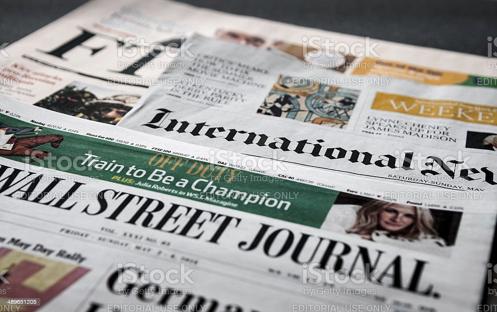 Bunch of international daily newspaper in English stock photo