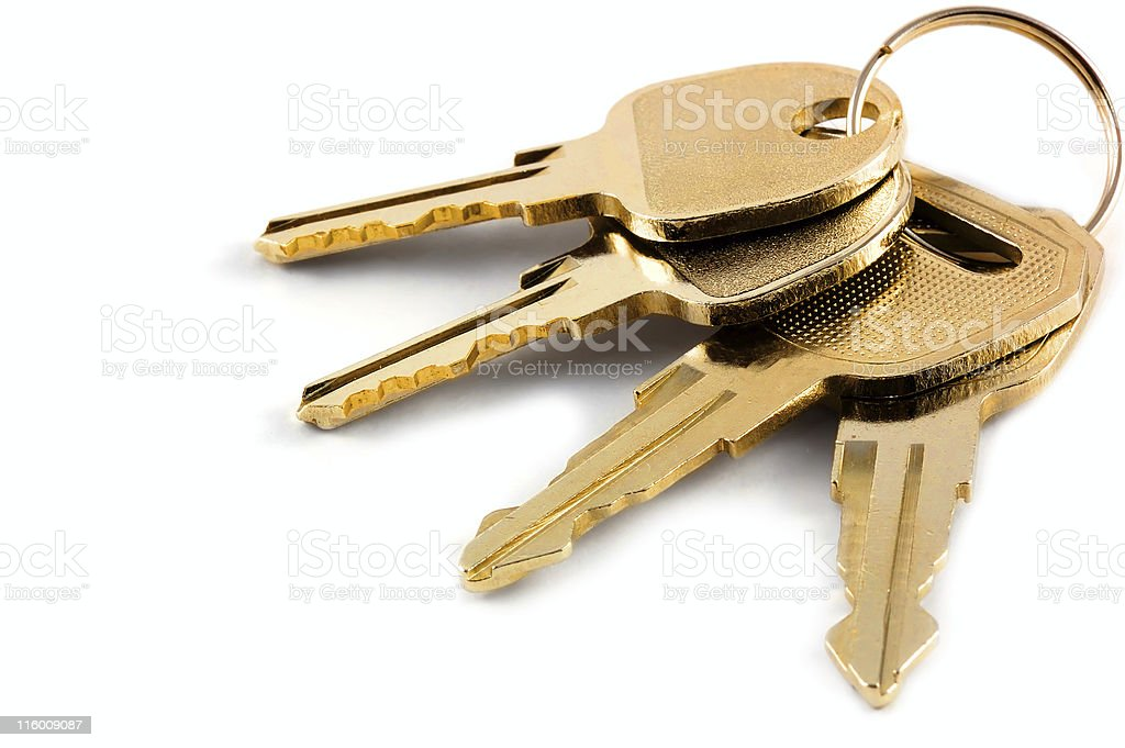 bunch of keys isolated against a clean white background stock photo