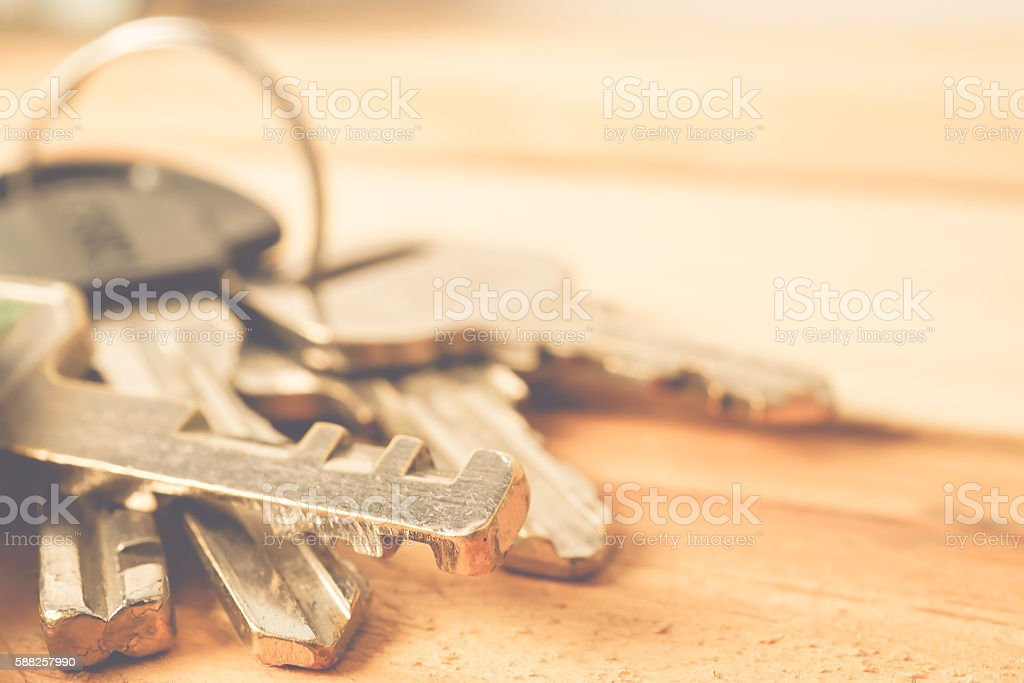 Bunch of keys on a wooden table stock photo