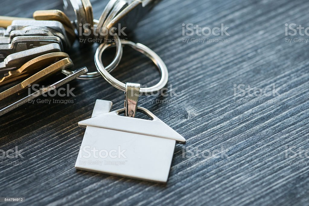 Bunch of keys with house shaped key ring stock photo