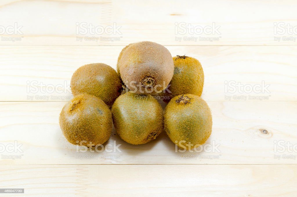 Bunch of kiwis on a wooden table royalty-free stock photo