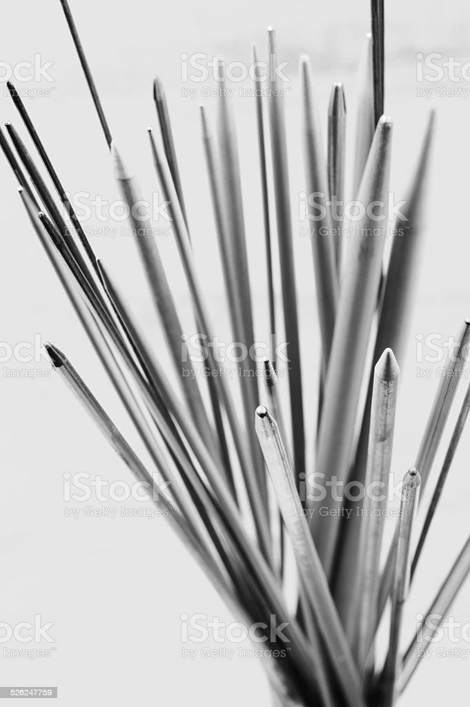 Bunch of knitting needles stock photo