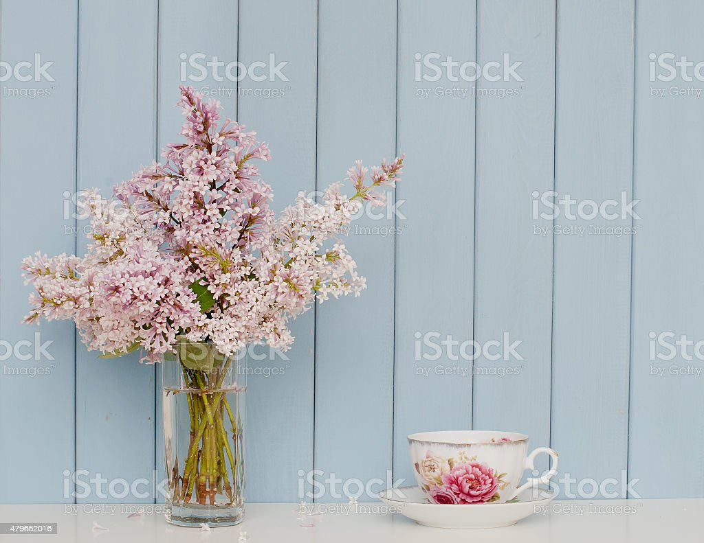 Bunch of lilac and teacup stock photo