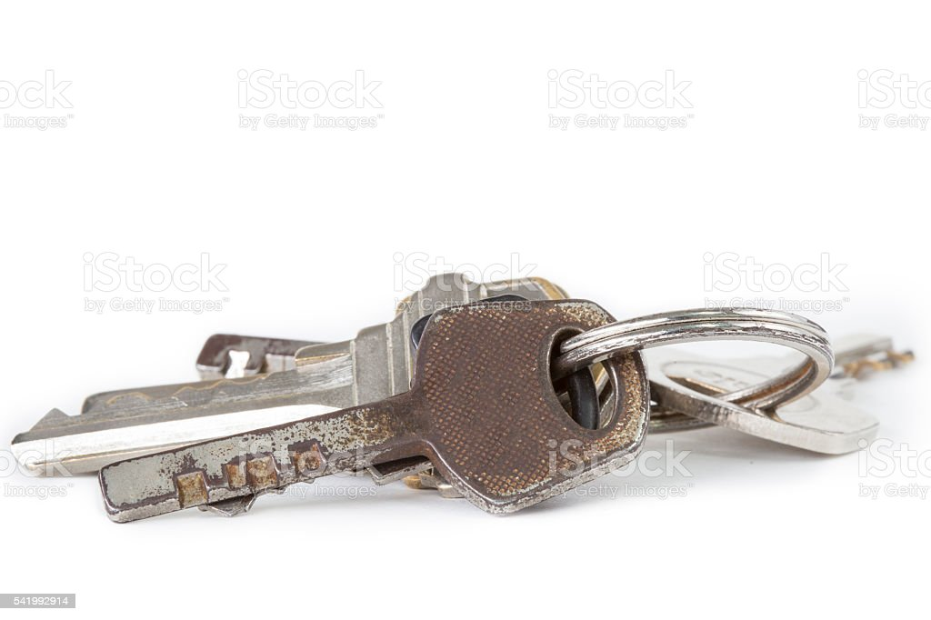 Bunch of old keys isolated on white background. stock photo