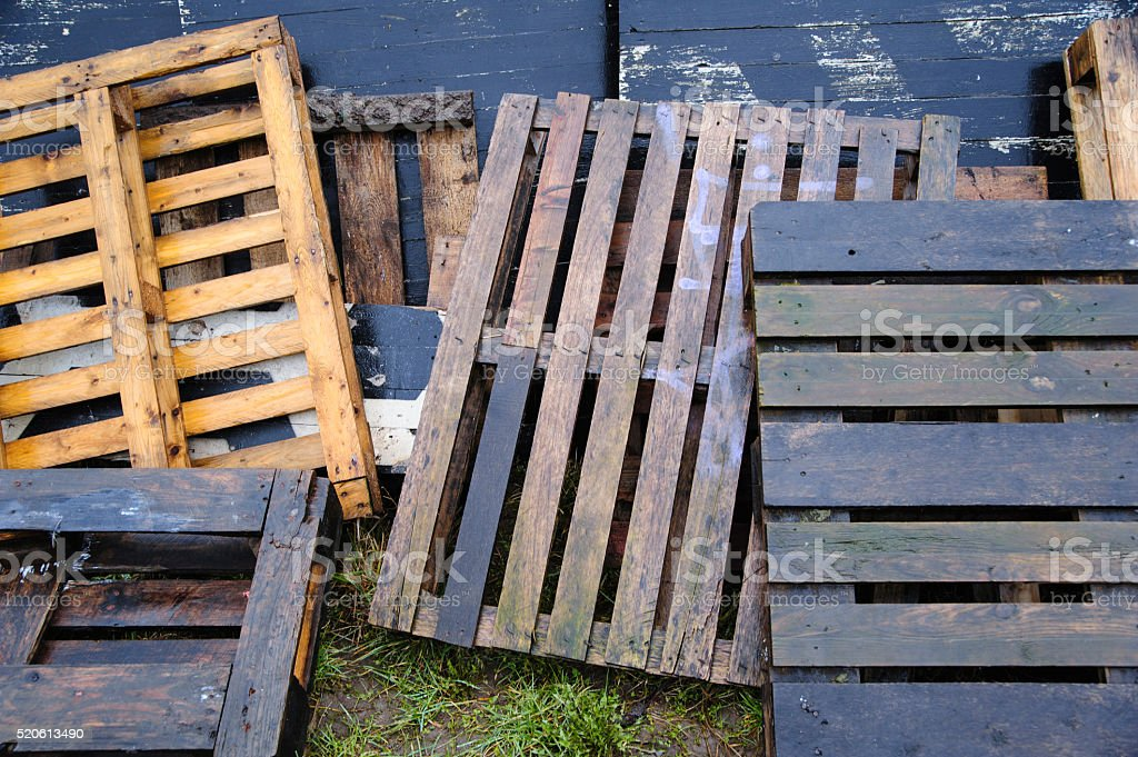 Bunch of old wet colored wooden pallets stock photo