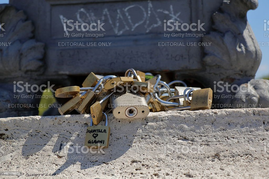 Bunch of padlocks of lovers on the bridge in Rome stock photo