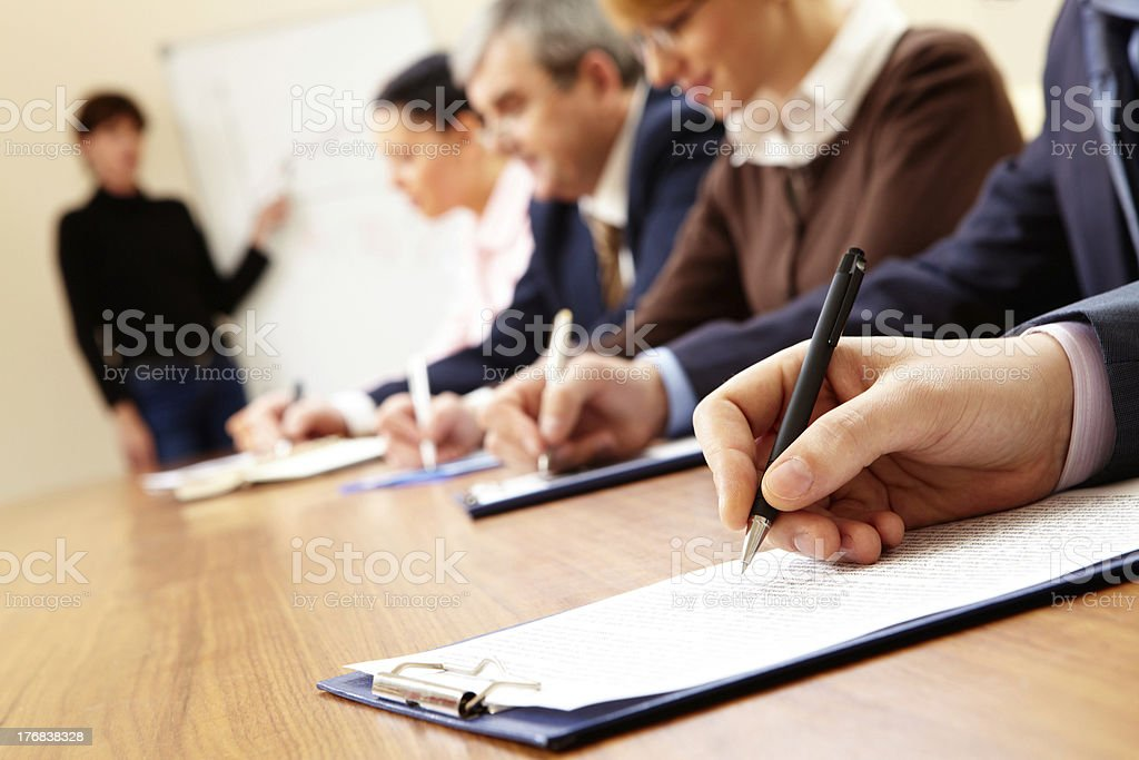 A bunch of people in a business meeting taking notes royalty-free stock photo