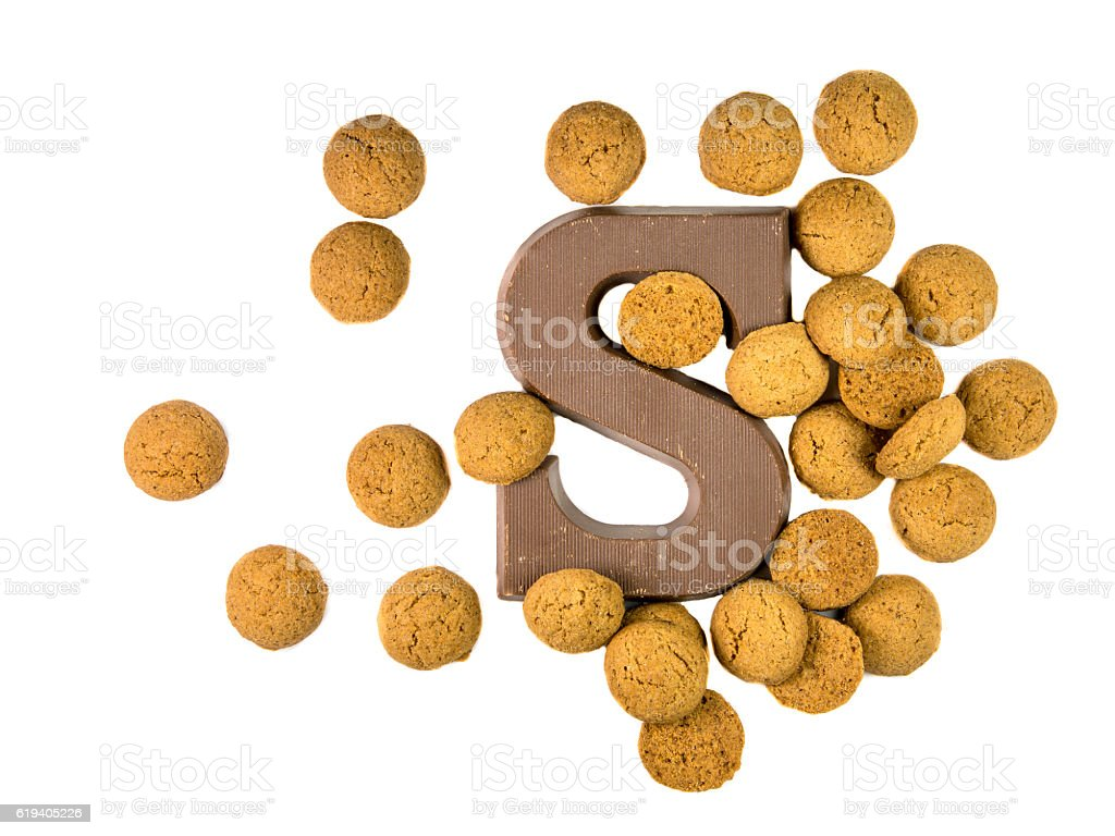 Bunch of Pepernoten cookies with chocolate letter stock photo