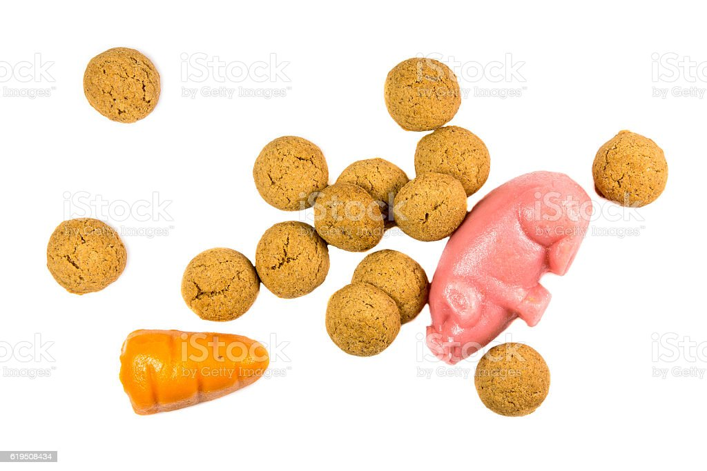 Bunch of Pepernoten cookies with marzipan pig and carrot stock photo