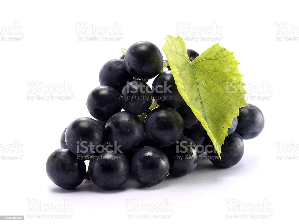 Bunch of purple grapes with stems stock photo