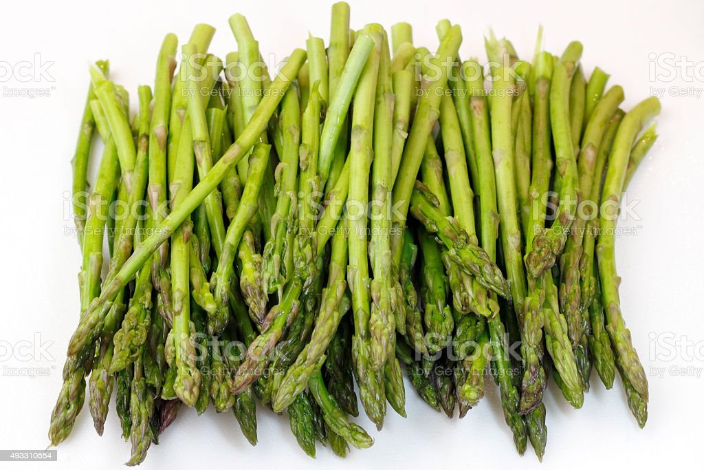 Bunch of Raw Asparagus on White stock photo