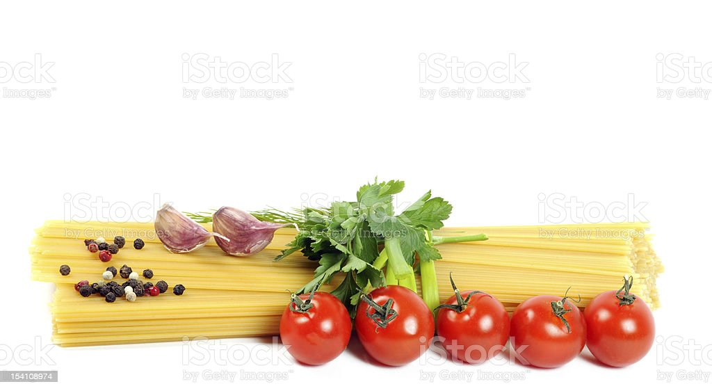 Bunch of raw spaghetti with tomato stock photo