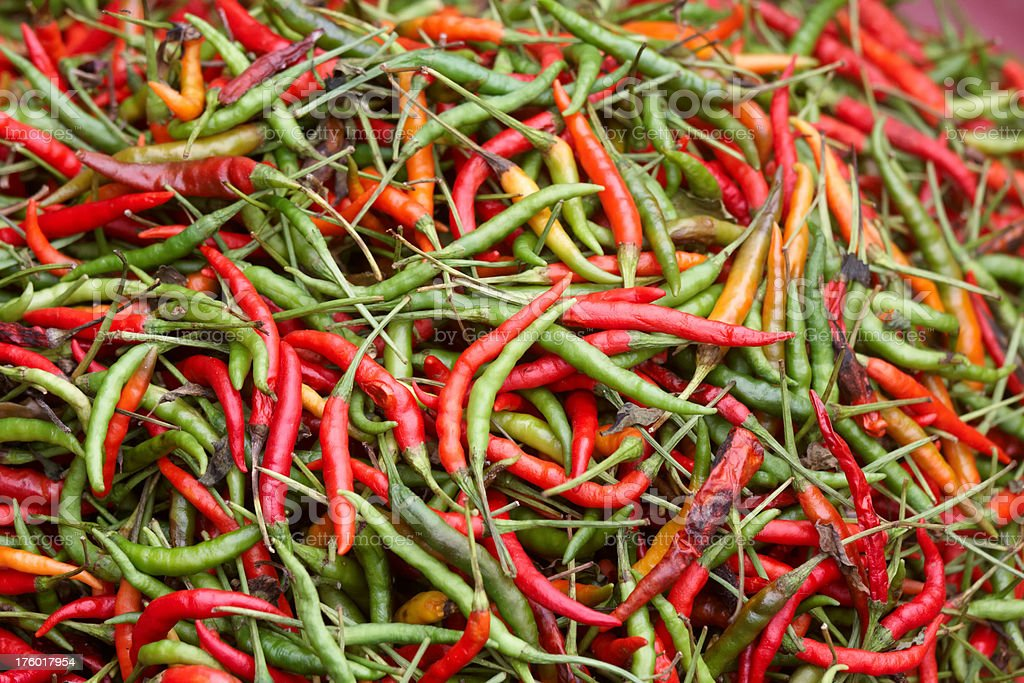 bunch of red and green hot chili peppers stock photo