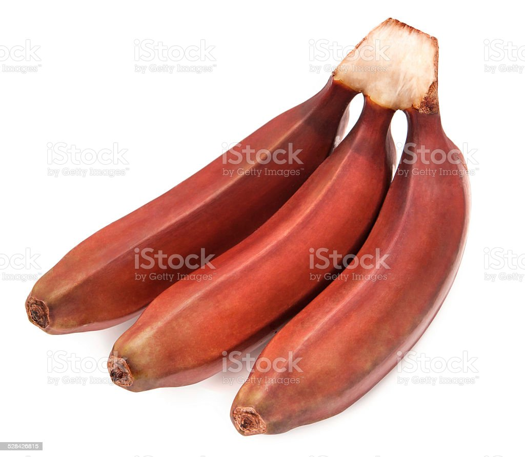 Bunch of red bananas fruit isolated over white background stock photo