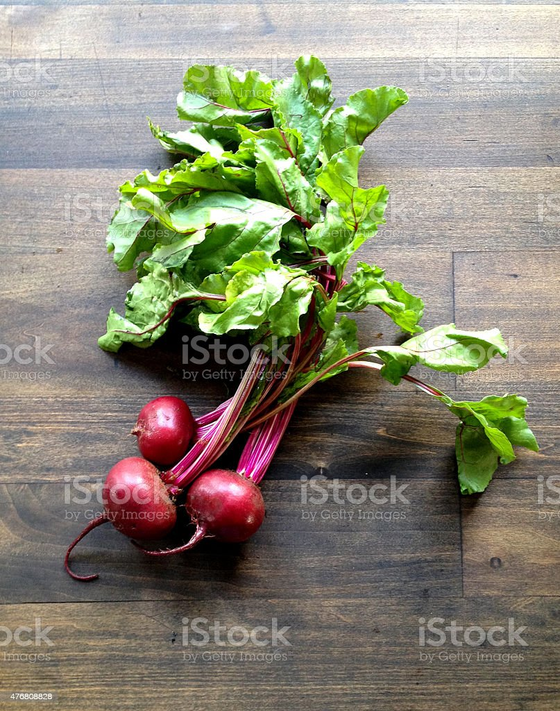 Bunch of Red Beets on Rustic Dark Wood Table Background stock photo