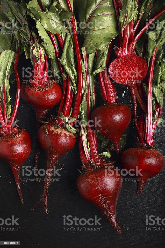 Bunch of red beets pulled from the ground stock photo