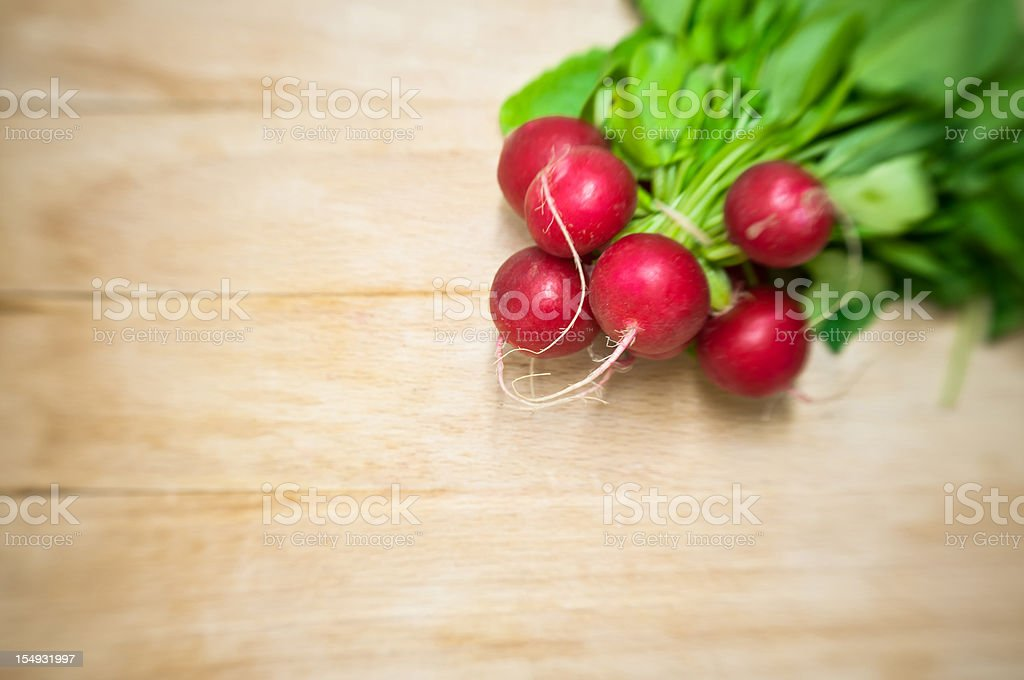 bunch of red radish on wood royalty-free stock photo