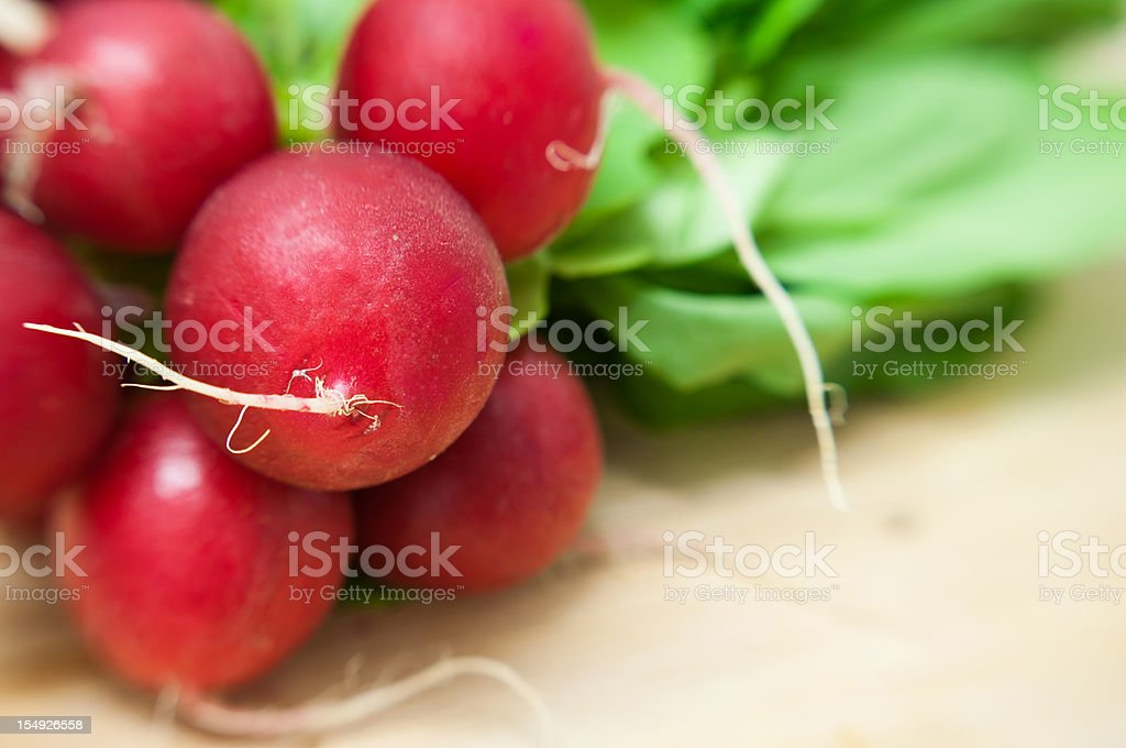 bunch of red radish on wood table stock photo