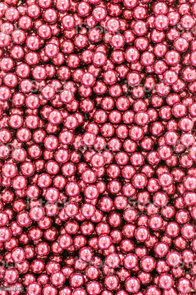 Bunch of red shiny beads stock photo