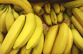 Bunch of ripened bananas at grocery store, closeup