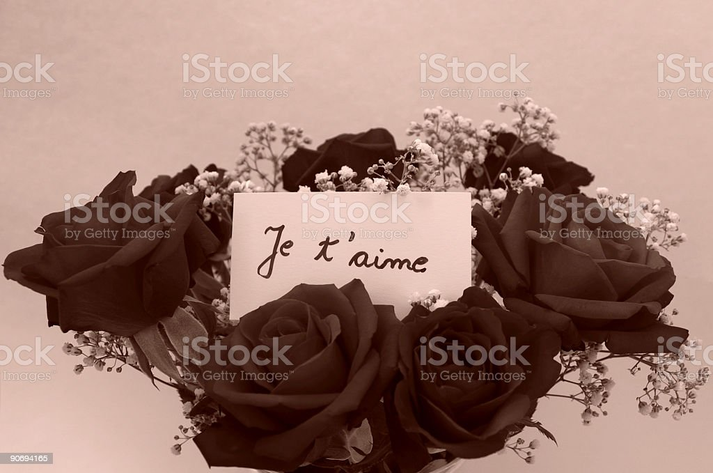 Bunch of roses with message tag stock photo