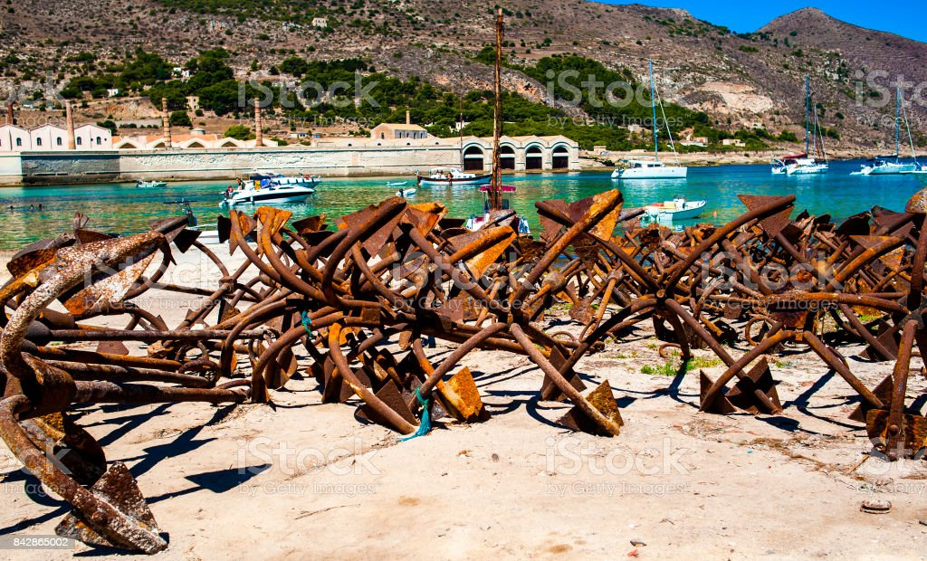 Bunch of rusty anchors in fisherman port in Favignana, Sicily. Italy stock photo