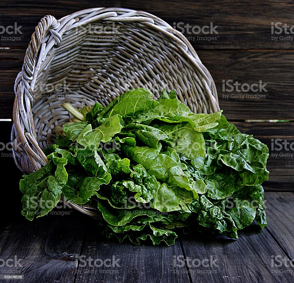 bunch of spinach in a basket stock photo