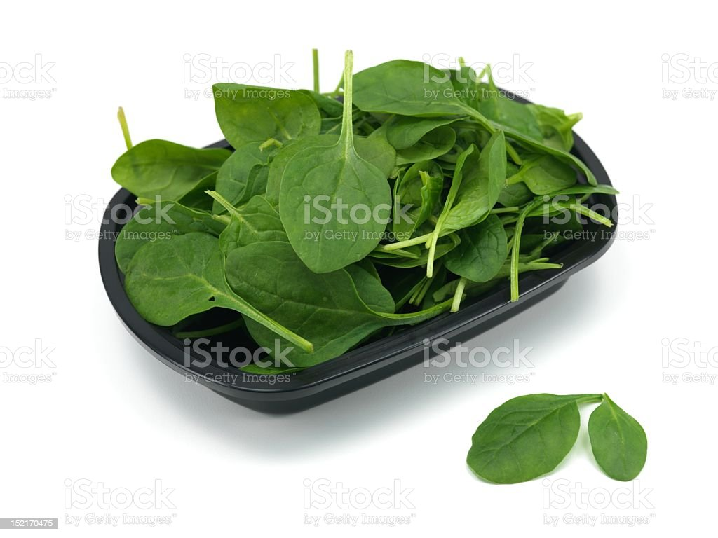 Bunch of spinach on plastic black plate stock photo