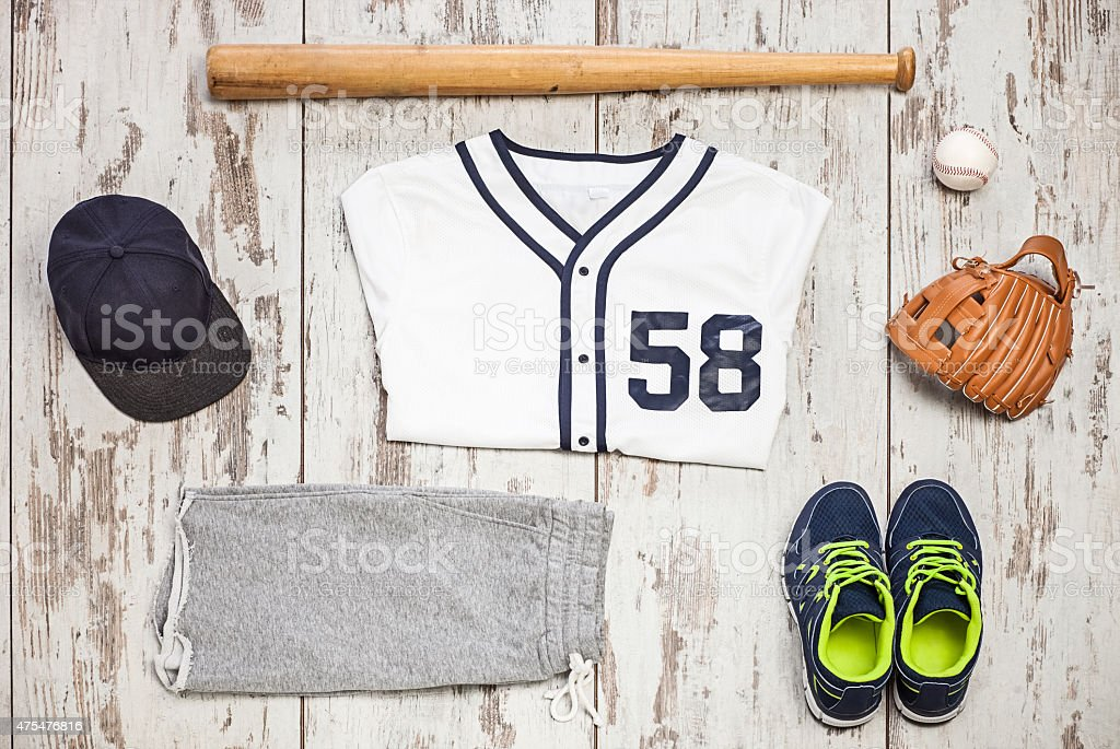 Bunch of sportswear and baseball equipment stock photo