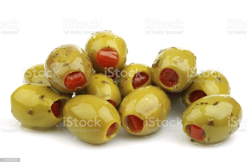 bunch of stuffed green olives stock photo