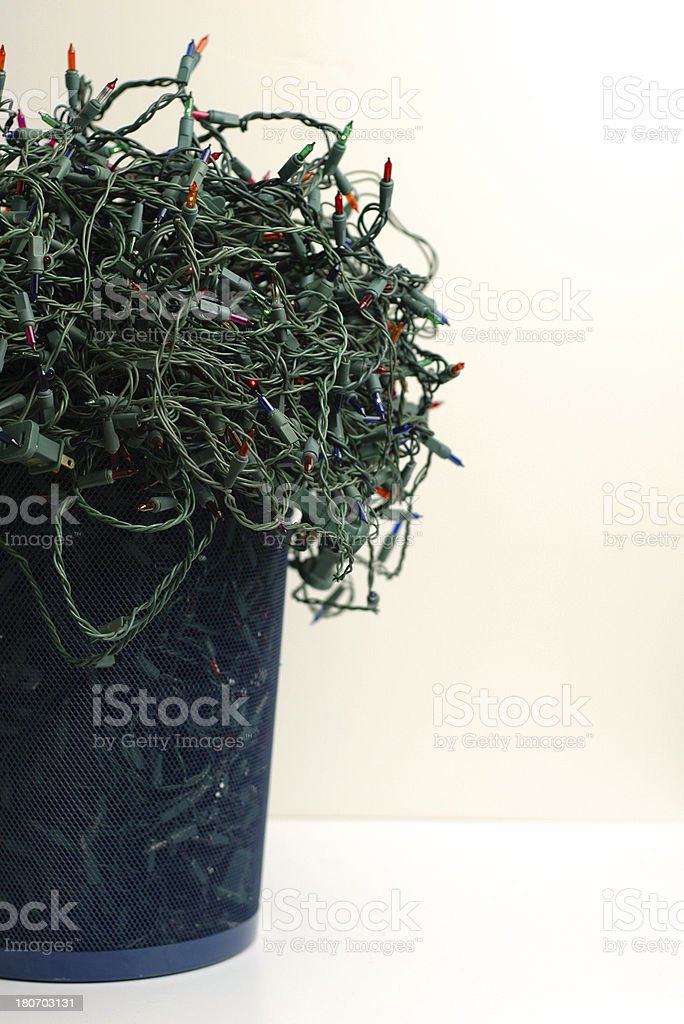 Bunch of Tangled Christmas Lights in Trash Can royalty-free stock photo