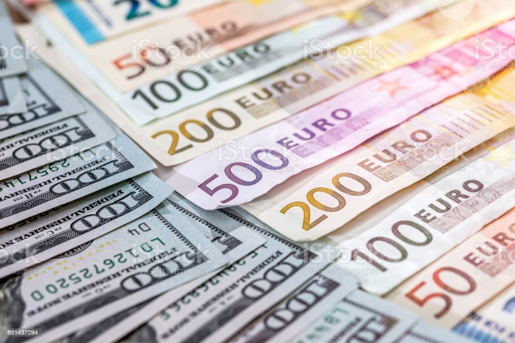 bunch of the two leading currencies - the US dollar and euro banknotes. stock photo