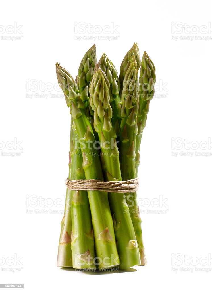 Bunch of tied asparagus isolated on white background. royalty-free stock photo