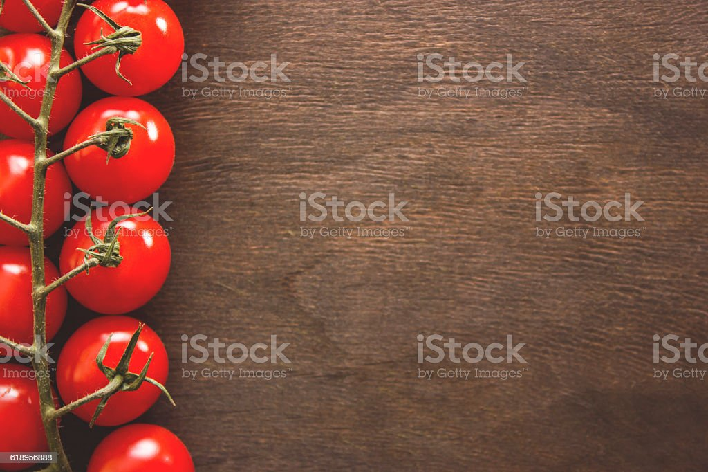 Bunch of tomatoes on a wooden background stock photo